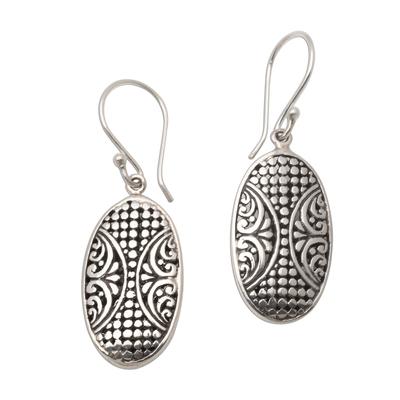 Sterling silver dangle earrings, 'Plentiful Seeds' - Dot Pattern Oval Sterling Silver Dangle Earrings from Bali