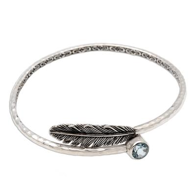 Blue topaz bangle bracelet, 'Sky Feather' - Handcrafted Sterling Silver Bangle Bracelet with Blue Topaz