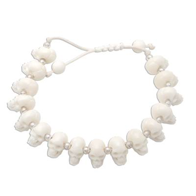 Bone beaded bracelet, 'Bone Collector' - Hand Carved Bone Skull Bead Bracelet