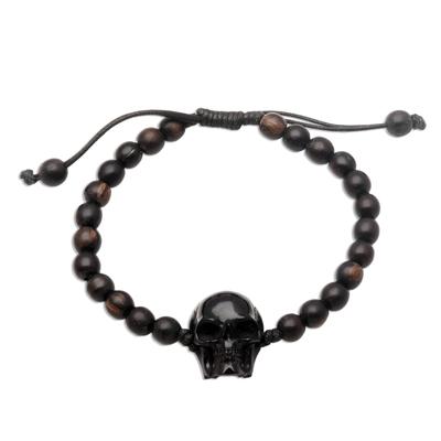 Beaded horn and wood pendant bracelet, 'Dark Visage' - Black Horn Skull Beaded Pendant Bracelet