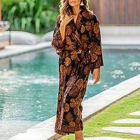 Long rayon batik robe, 'Tropical Leaves' - Hand Stamped Black and Spice Rayon Long Robe from Bali