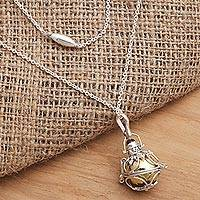 Garnet harmony ball necklace, 'Protective Love' - Silver and Brass Harmony Ball Necklace with Garnet