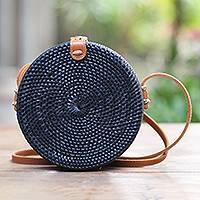 Bamboo shoulder bag, 'Midnight Lombok Circle' - Handwoven Black Bamboo Shoulder Bag with Faux Leather Strap