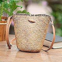 Leather accent rattan sling bag, 'Monochrome Chic' - Handwoven Beige Rattan Sling Bag with Tan Leather Trim