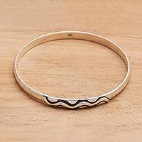 Sterling silver bangle bracelet, 'Rapids' - Sterling Silver Bangle Bracelet with Oxidized Motif