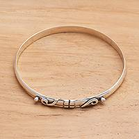 Sterling silver bangle bracelet, 'Wrap It Up' - Ribbon Motif Sterling Silver Bangle Bracelet