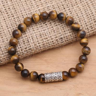 Tiger's eye and sterling silver beaded stretch bracelet, 'Flow Direction in Brown' - Sterling Silver Pendant Bracelet with Tiger's Eye Beads