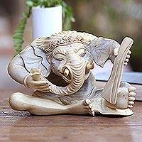 Hibiscus wood sculpture, 'Ganesha with Manuscript'