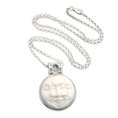Blue topaz pendant necklace, 'Moon Phase Faces' - Blue Topaz and Sterling Silver Moon Pendant Necklace