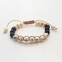 Bone beaded bracelet, 'For Unity' - Balinese Black Lava Stone Unity Bracelet with Bone