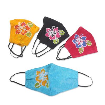 Rayon batik face masks, 'Vibrant Hibiscus' (set of 4) - 4 Hand-Painted Rayon Batik Contoured Cotton Face Masks