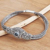 Blue topaz pendant bracelet, 'Forest Circle' - Balinese Sterling Silver Pendant Bracelet with Blue Topaz