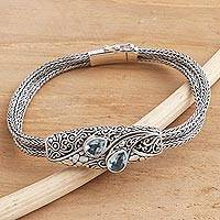Blue topaz pendant bracelet, 'Two Pears' - Balinese Sterling Silver Pendant Bracelet with Blue Topaz