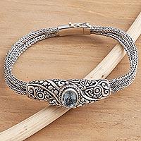 Blue topaz pendant bracelet, 'Double Naga' - Balinese Blue Topaz Bracelet with Sterling Silver Naga Chain