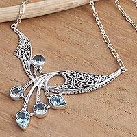 Blue topaz pendant necklace, 'Winged Dreams'