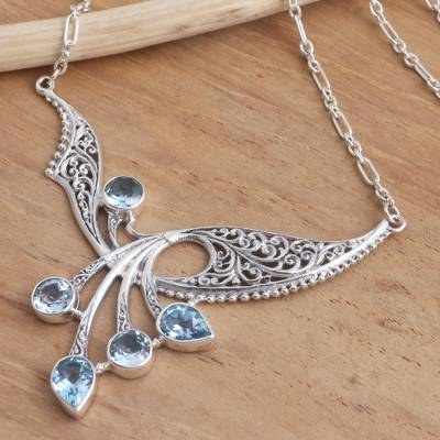 Blue topaz pendant necklace, 'Winged Dreams' - Balinese Blue Topaz Sterling Silver Pendant Necklace