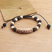 Lava stone beaded bracelet, 'Suggestion of Peace' - Hand Carved Lava Stone Beaded Peace Bracelet
