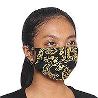 Rayon batik face masks, 'Golden Island Foliage' (set of 3) - 3 Black and Yellow Pleated Rayon Batik Face Masks