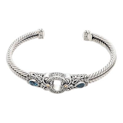 Gold-accented blue topaz cuff bracelet, 'Hidden Gate in Blue' - Handmade Sterling Silver and Topaz Cuff Bracelet from Bali