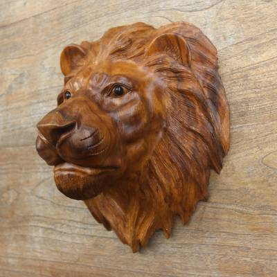 Wood wall sculpture, 'King of Cats' - Suar Wood Lion Head Wall Sculpture with Onyx Eyes