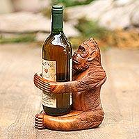 Wood wine holder, 'Monkey Hug' - Handmade Suar Wood Monkey Wine Holder