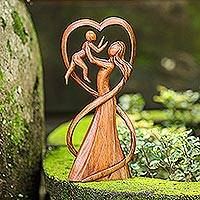 Wood statuette, 'Reunion' - Hand Carved Suar Wood Mother and Child Statuette