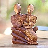 Wood statuette, 'Family Love' - Parents Embrace a Newborn in Indonesian Sculpture