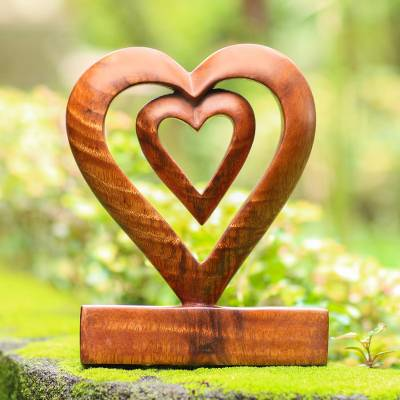 Wood statuette, 'Two Loves in Brown' - Hand Carved Natural Suar Wood Heart Statuette