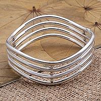 Sterling silver bangle bracelet, 'Water Waves' - Hand Made Sterling Silver Bangle Bracelet