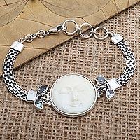 Blue topaz pendant bracelet, 'Full Moon Beauty' - Blue Topaz and Sterling Silver Moon-Themed Bracelet