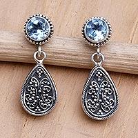 Blue topaz dangle earrings, 'Mystic Leaves in Blue' - Sterling Silver and Blue Topaz Dangle Earrings from Bali