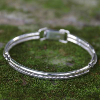 Sterling silver bangle bracelet, 'Melody' - Handmade Sterling Silver Bangle Bracelet