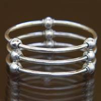 Sterling silver bangle bracelet, 'Cosmic Trio'