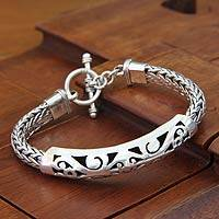 Sterling silver braided bracelet, 'Mystic Symbols' - Artisanmade Sterling Silver Braided Bracelet