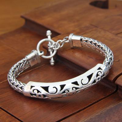 Sterling silver pendant bracelet, 'Mystic Symbols' - Artisanmade Sterling Silver Braided Bracelet