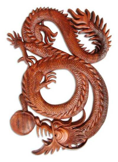 Wood relief panel carved in indonesia dragon plays ball