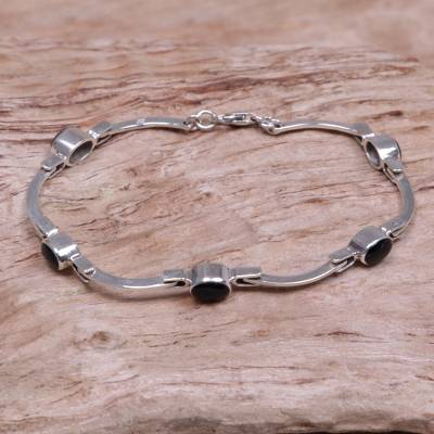 Onyx link bracelet, 'Black Rice Seeds' - Sterling Silver Onyx Bracelet from Indonesia