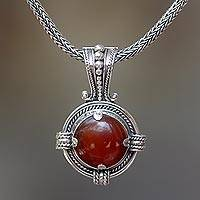 Carnelian pendant necklace, 'Russet Oracle' - Carnelian Pendant Necklace with Balinese Sterling Silver