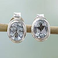 Blue topaz stud earrings, 'Sky Duet' - Silver Earrings Featuring Oval Blue Topaz Stones