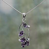 Amethyst floral necklace, 'Wisteria Blossoms' - Fair Trade Sterling Silver and Amethyst Pendant Necklace