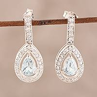 Blue topaz dangle earrings, 'Arctic Tear' - Artisan Crafted Blue Topaz and Cubic Zirconia Earrings