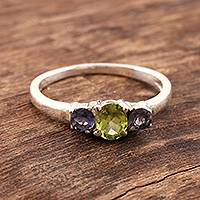 Iolite and peridot 3 stone ring, 'Blue Embrace'