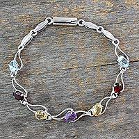 Garnet and blue topaz link bracelet, 'Colors of Life' - Garnet and blue topaz link bracelet