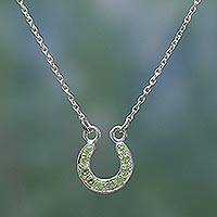 Peridot pendant necklace, 'Lucky Horseshoe' - Hand Made Sterling Silver and Peridot Necklace from India