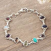 Lapis and rainbow moonstone tennis bracelet, 'Color Medley' - Oval Gemstone Linked Bracelet with Garnet, Amethyst, & Lapis