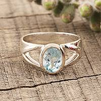 Blue topaz solitaire ring, 'Gentle Kiss' - Artisan Crafted Sterling Silver and Blue Topaz Ring
