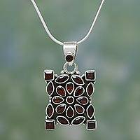 Garnet pendant necklace, 'Scarlet Daisy' - Garnet Flower Necklace in Sterling Silver Jewelry from India
