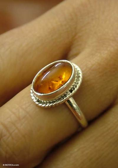 Amber solitaire ring,