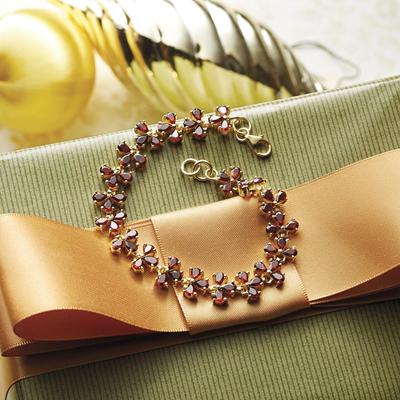 Gold plated garnet link bracelet, 'Sisodia' - Handcrafted Gold Vermeil and Garnet Bracelet