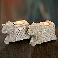 Featured review for Soapstone candleholders, Versatile Elephants (pair)